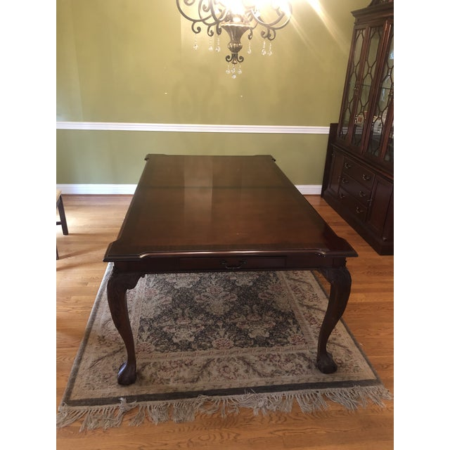 This beautiful Georgian style solid mahogany table was a beloved part of my grandmother's dining room that I inherited 9...
