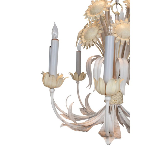 White and yellow painted tole chandelier with sun flower decoration, eight-arm. We have a smaller one with six arms.