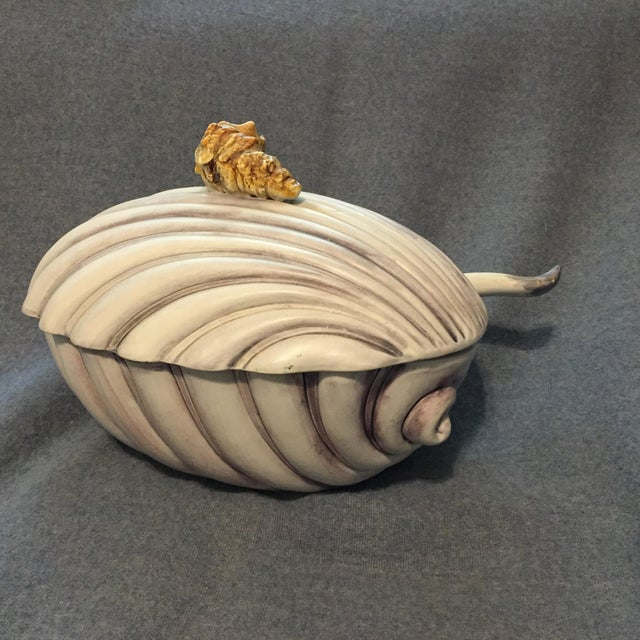 Gorgeous vintage Majolica soup tureen made in Italy, with a seashell finial on the lid, and original serving spoon.
