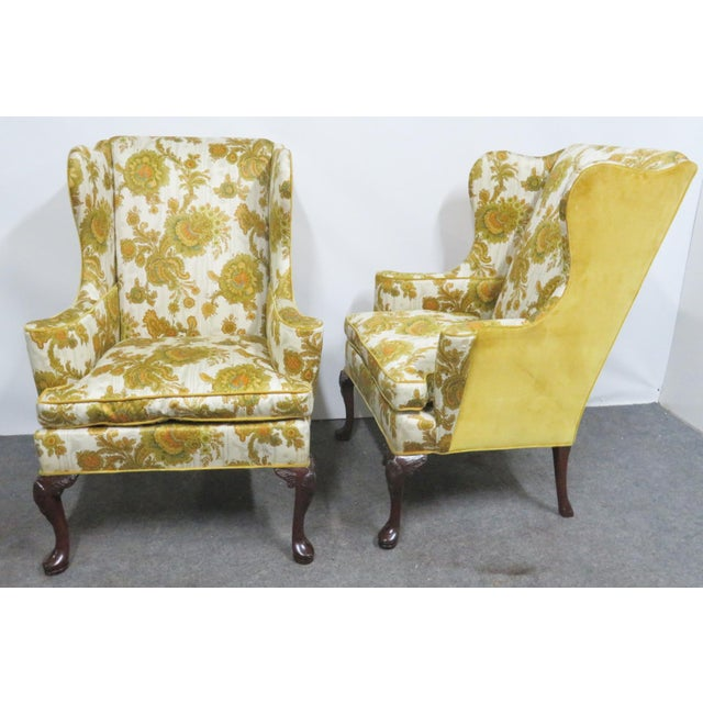 Hickory Chair Co tag. Yellow paisley upholstery with yellow upholstered back. Mahogany legs with shell motif surrounded by...