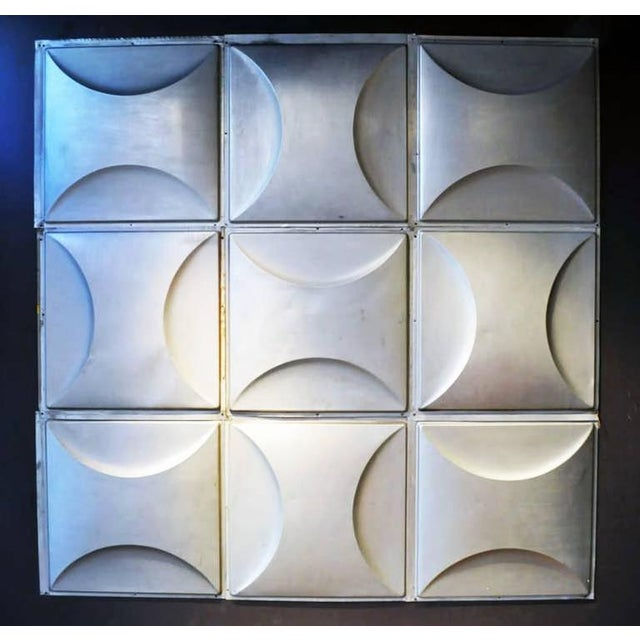 When arranged in a large grid these silvery metal squares break the mold in wall decor. The matte finish and gentle curves...