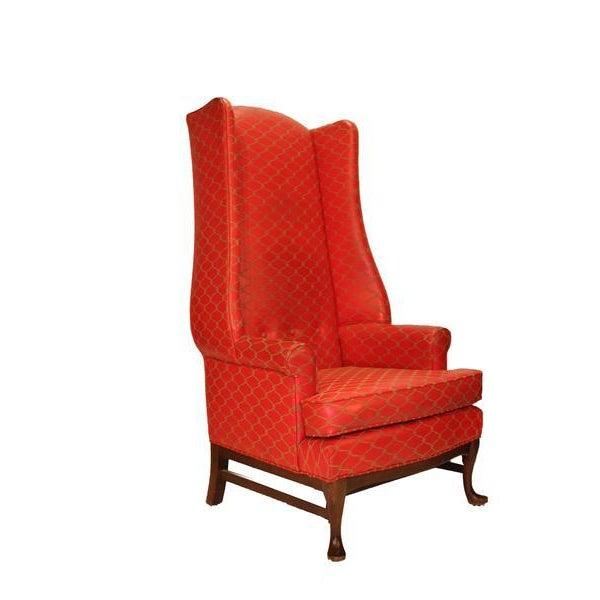 A beautiful pair of tall wing backed chairs in red leather with gold embroidery. Very Elegant statement pieces. The chairs...