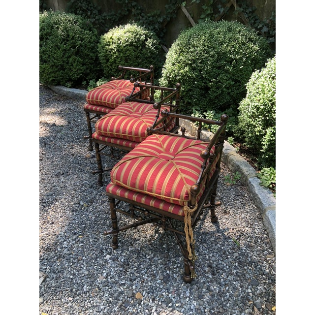 Funky bronzed stick and ball faux bamboo bench in bronzed iron. Custom upholstery in red, gold and ivory stripe. Gold...
