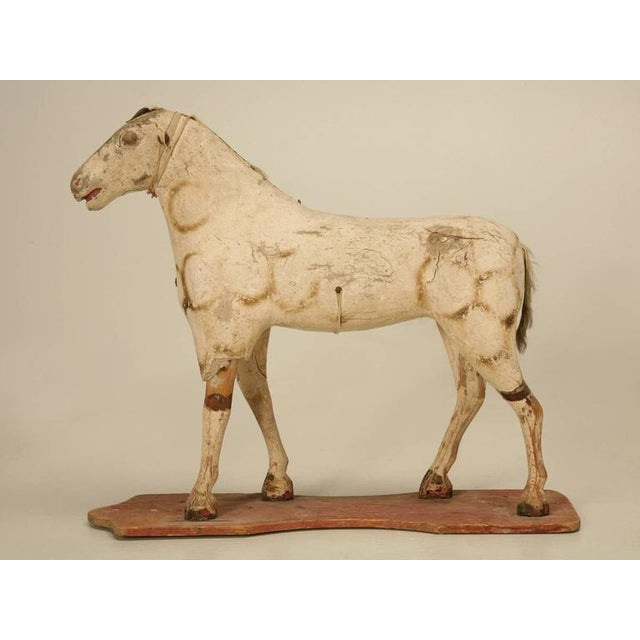 Antique child's horse made from papier mâché draped over a wooden frame and purchased in America about 40 years ago. Makes...