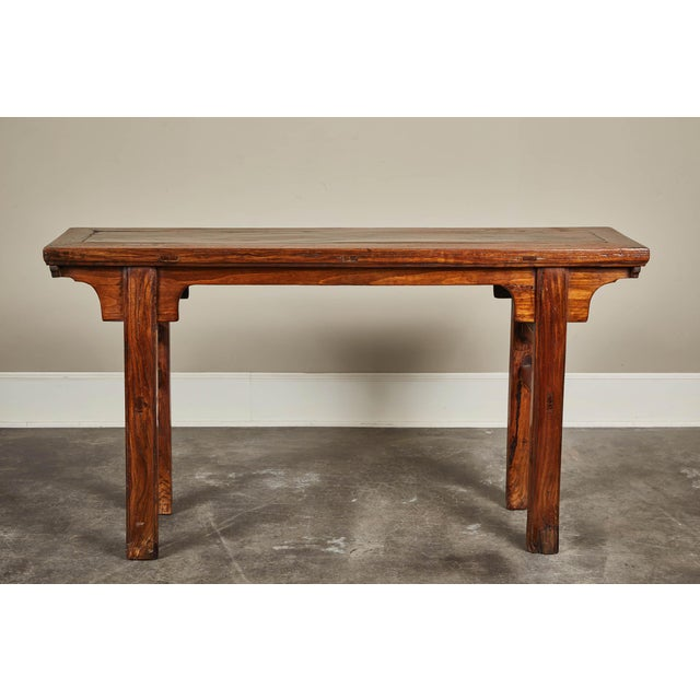 A 19th century Chinese Ming-style altar table made of elm. From Hebei.