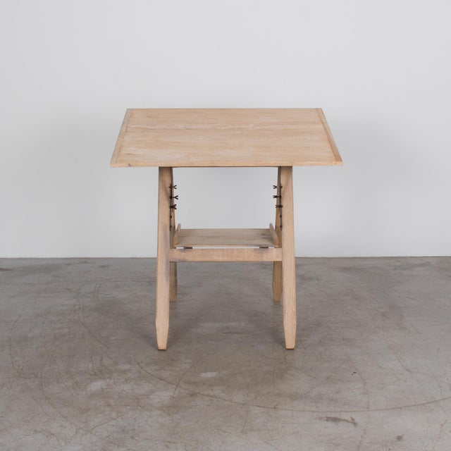 with oak frame and beech top, this practical writing or drawing table comes from Belgium, c. 1920. Wood and metal create a...