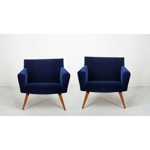 A stunning pair of Italian style Mid-Century occasional chairs in plush indigo velvet. Legs have been refinished.