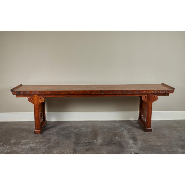 A Ming style single piece elm top scroll end altar table. Originally from Shanxi, China.