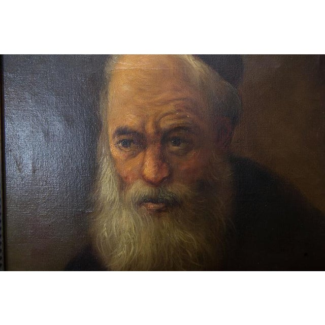This sombre and imposing oil painting on canvas presents a religious figure in regalia, 20th century.