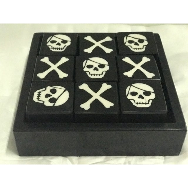 Super fun Skull and Bones Tic Tac Toe table game made of bone. Great table top decoration and game.