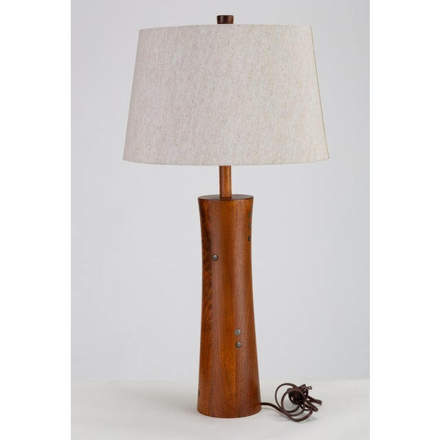 A lathe-turned walnut lamp from Midwestern ceramics artists Gordon and Jane Martz for their company Marshall Studios. The...