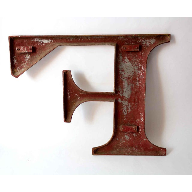 Large metal letter F, painted gold. A warm piece with rich texture, we love this as a statement in the entryway or a focal...