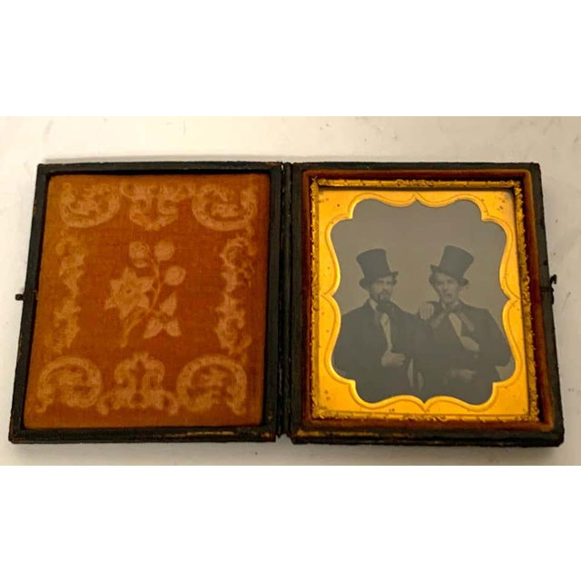 Sixth plate Daguerreotype Portrait of two seated cigar smoking, embracing young men wearing top hats, Western bow ties and...