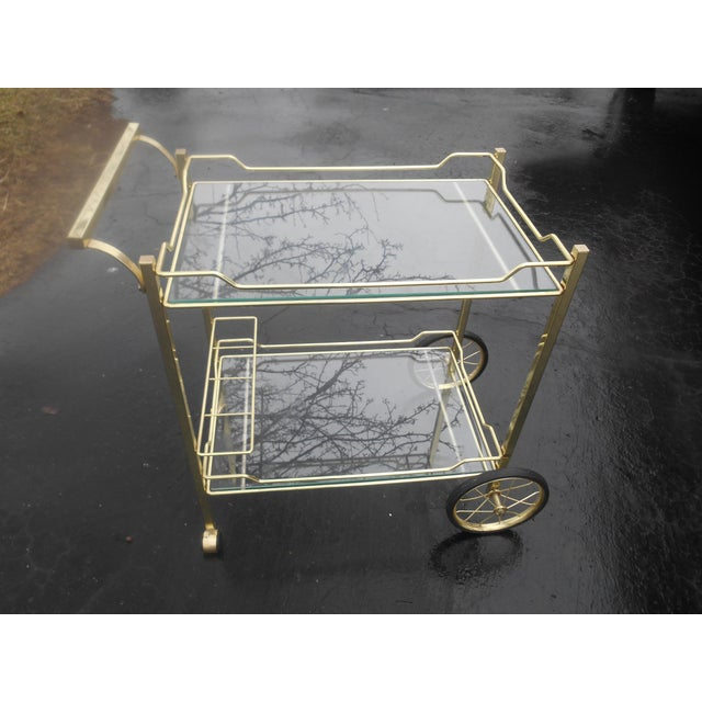 This rolling cart is in terrific condition and the brass is shiny. The two-tier glass tops are perfect. This cart has...