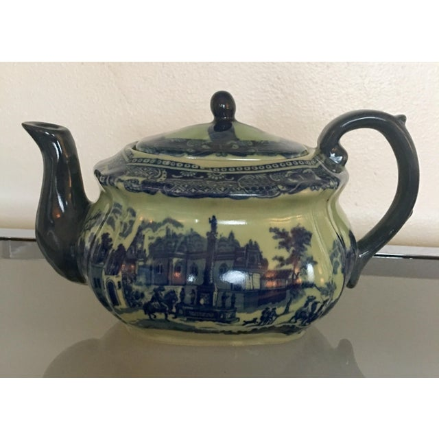 Vintage Victoria Ware Ironstone Flow Blue English Teapot. Scene depicting old English style town.