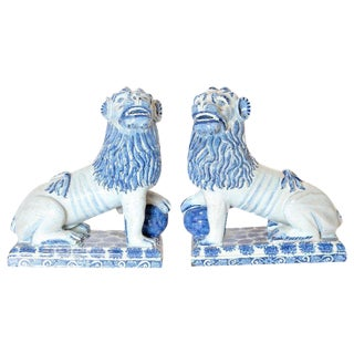 Pair of 18th Century French Faience Seated Lions For Sale