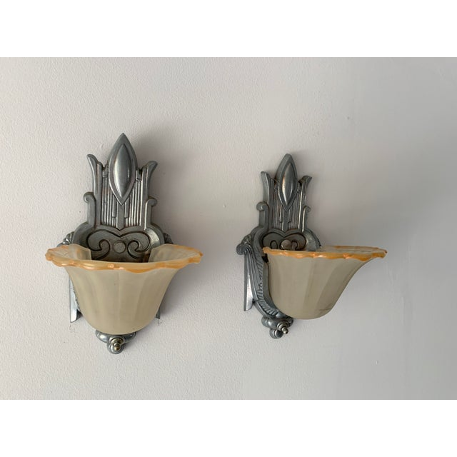Incredible, antique Art Deco sconces. These light fixtures date from the early to mid 30s when Art Deco was at its glory....