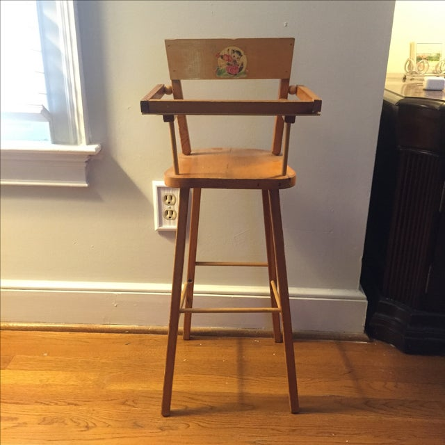 Adorable vintage light yellow wooden doll high chair with a sweet cat and the fiddle nursery decal on the back. It's in...