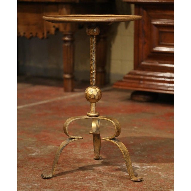 This elegant, antique pedestal table was crafted in Southern France, circa 1920. The intricate martini table features a...