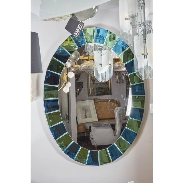 Custom oval mirror with blue and green beveled mirror squares surround.