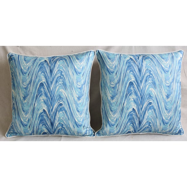 Pair of custom-tailored pillows in new unused blue and white marbleized swirl pattern cotton fabric. New bone-white...