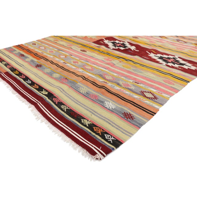 This vintage Turkish Kilim rug displays symbolic motifs and bright hues make a statement and create a sense of animation....