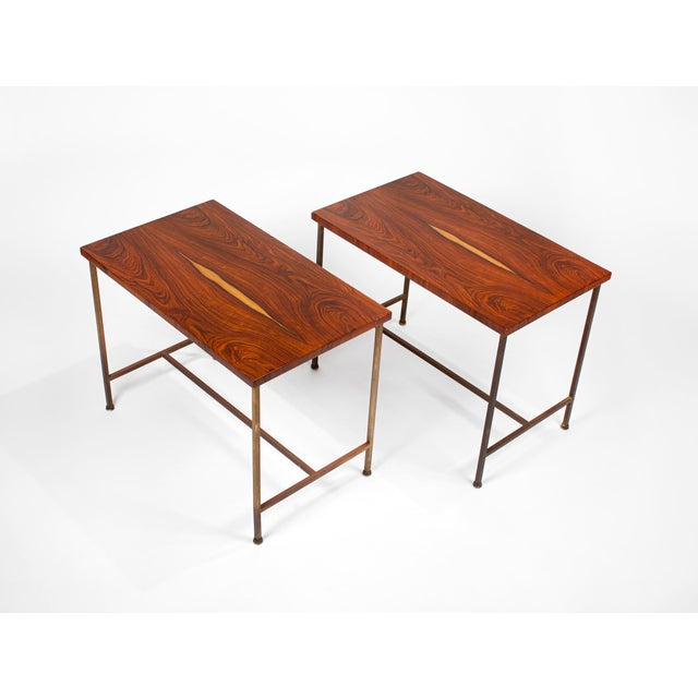 Rare side tables with beautiful book-matched rosewood tops and brass frames designed by Paul McCobb for Calvin, 1952.