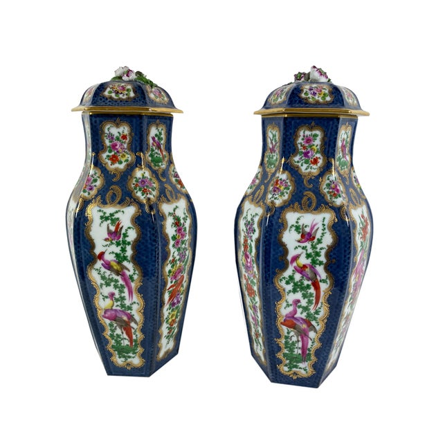 A pretty pair of English Worcester vases with lids depicting florals and birds. Circa 1900 Older repair to one lid, well...