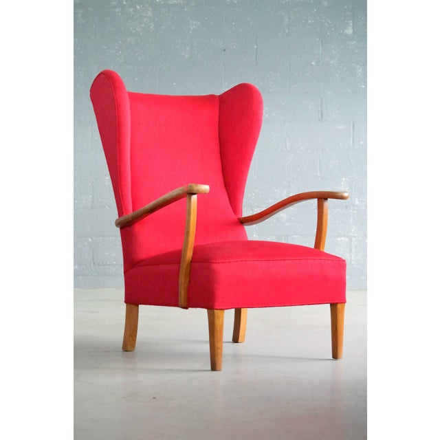 Very cool Danish wingback lounge chair from circa 1950 attributed to Fritz Hansen and slightly more modern but very...