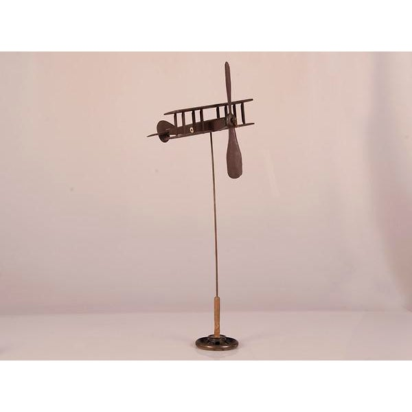 A handsome hand carved and painted wooden Biplane from England c.1940 mounted on a custom stand.