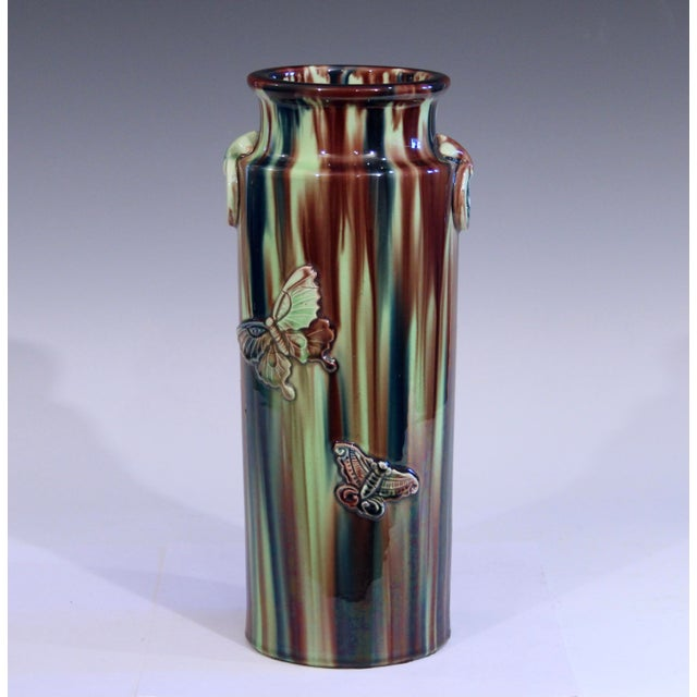 Antique Awaji Style pottery vase in cylinder form with ring handles and sprigged butterflies and hibiscus blossoms, circa...