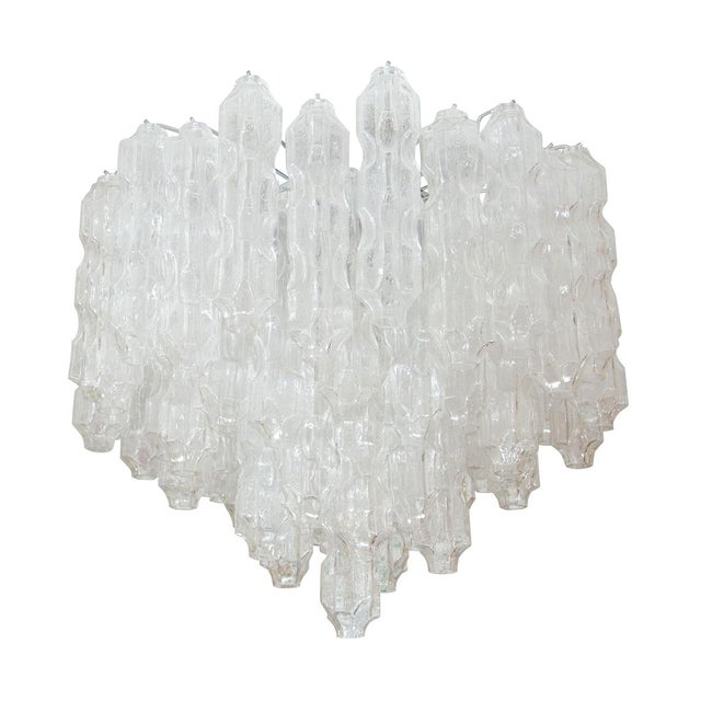 Multitiered Chandelier Composed of Textured Glass Elements For Sale