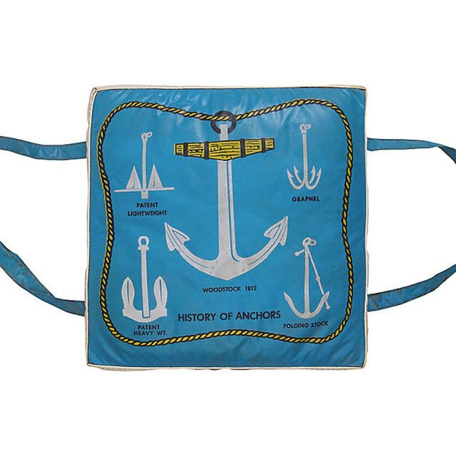 Vintage original blue and white vinyl boat cushion with the history of anchors graphics. Measurements are of actual...