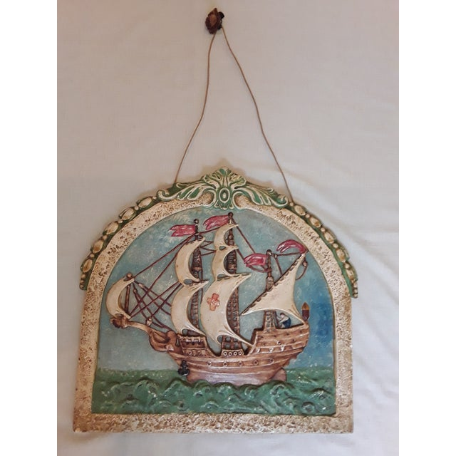 This unusual painted plaster wall plaque features an ocean vessel in full sail. The original picture rail hanger is...