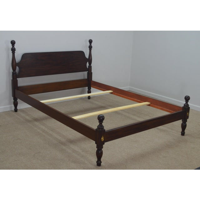 Full size bed by Henkel Harris. It features solid mahogany wood, cottonball posts, turned legs and brass plates.