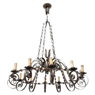 Grand Antique French Twelve-Light Wrought Iron Chateau Chandelier For Sale