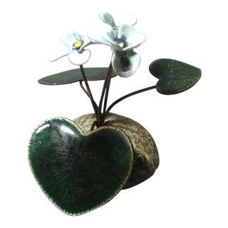 Mid Century Modern Enameled Metal Flower Mounted on Plaster For Sale