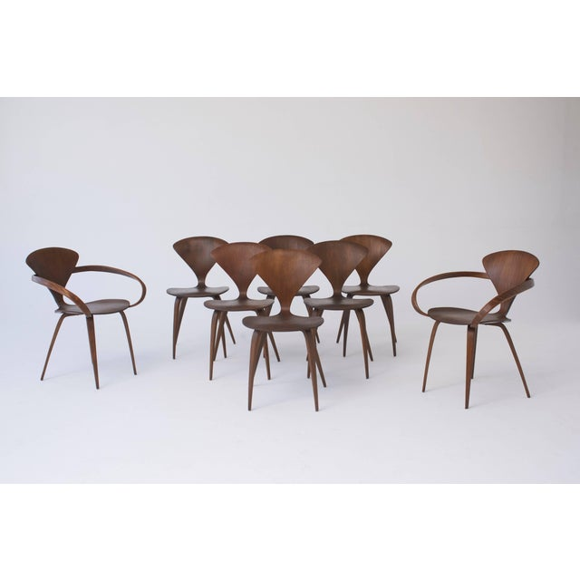 A rare full set of eight original Norman Cherner dining chairs, made by Plycraft USA in the 1960s. Six side chairs and two...