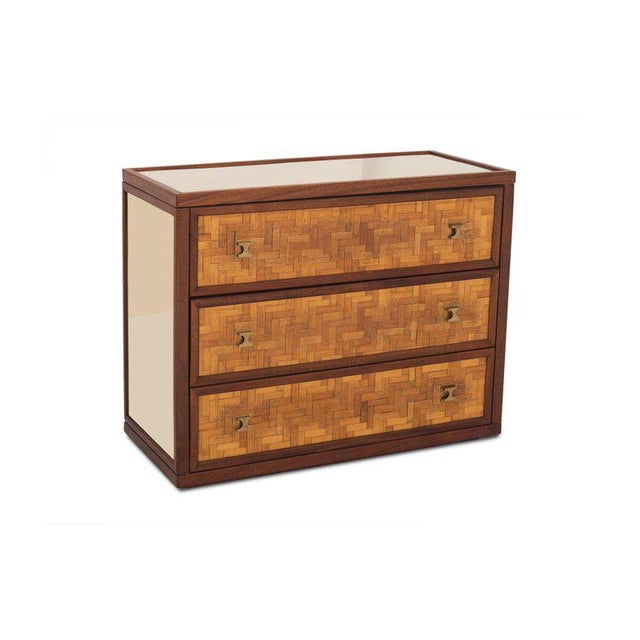 Teak sideboard in the style of Harvey Probber with reflecting brass side panels and top, equipped with three large rattan...