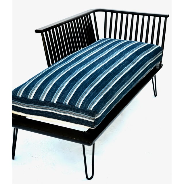 Beautiful simple glamorous daybed with versatility, features metal tapered legs, lacquered finish wood and fantastic...