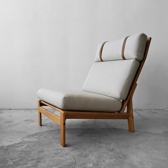 Rare solid oak framed Danish high back lounge chair by Komfort Design. This chair had a gently reclined position that give...