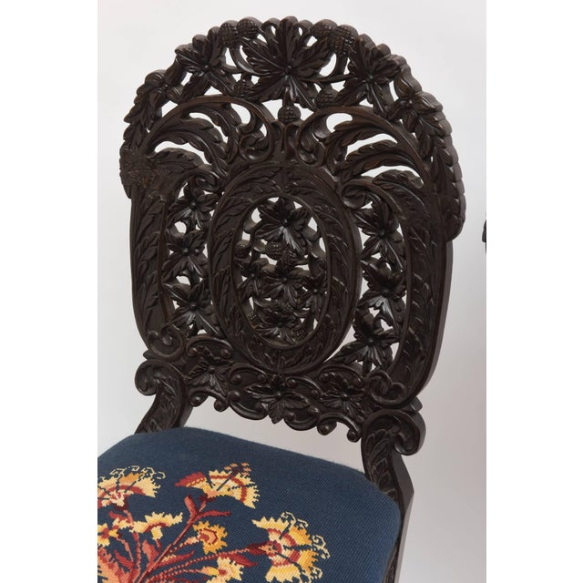 An exceptional and rare set of 4 with superior and intricate leaf and berry carving. Unusual form and style.
