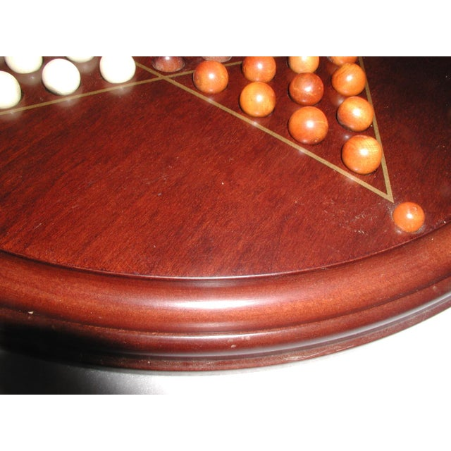 Vintage, 20th century Chinese checkers board game. The board is made of handsome cherry with beautiful tones to the wood...