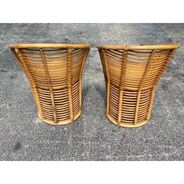 Fab pair of rattan side chairs. Concentric circles pattern radiating from the seat to the bottom of each chair. Coastal...