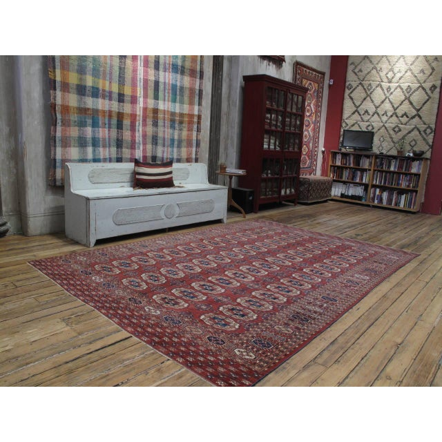 A handsome antique tribal carpet, woven by the Tekke Turkmen tribal groups in Central Asia. Featuring one of the most...
