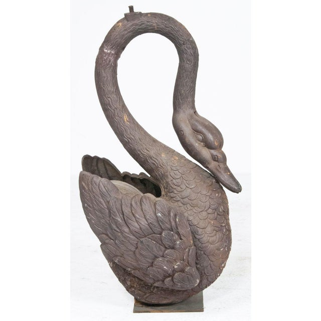 Cast Iron Swans mounted on later stands. Made in the US probably around 1870.