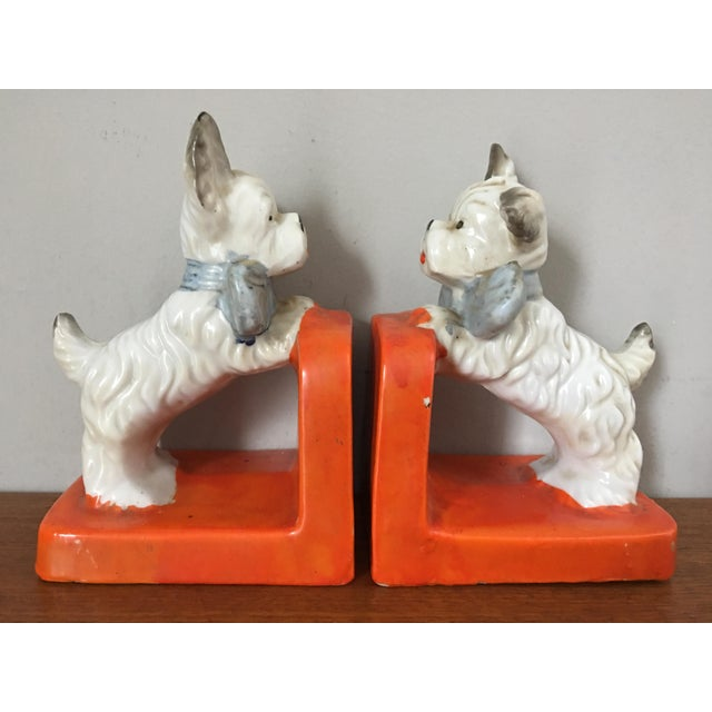 Offered is a vintage pair of ceramic terrier bookends. Marked Made in Japan. Flea bite chip to ear of one dog.