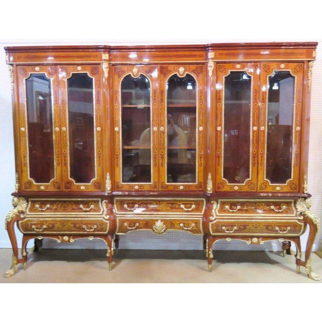 """Inlaid frame. Figural metal mounts with hoof feet. Set includes desk, chair and china cabinet. Desk: 21 1/2""""h x 72""""w x..."""