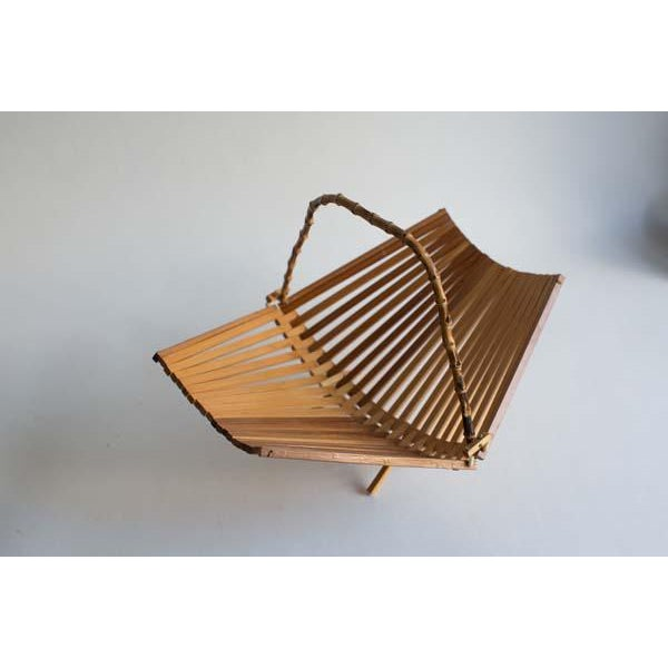 A petite teak fruit basket, that folds up easy when you don't need it anymore!