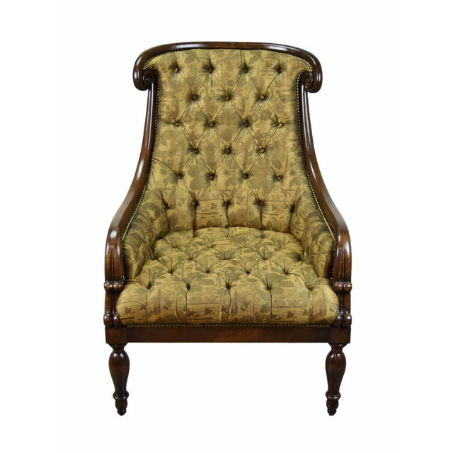 William Switzer hand carved Louis Philippe style lounge chair with French nails and button tufted upholstery. Generously...